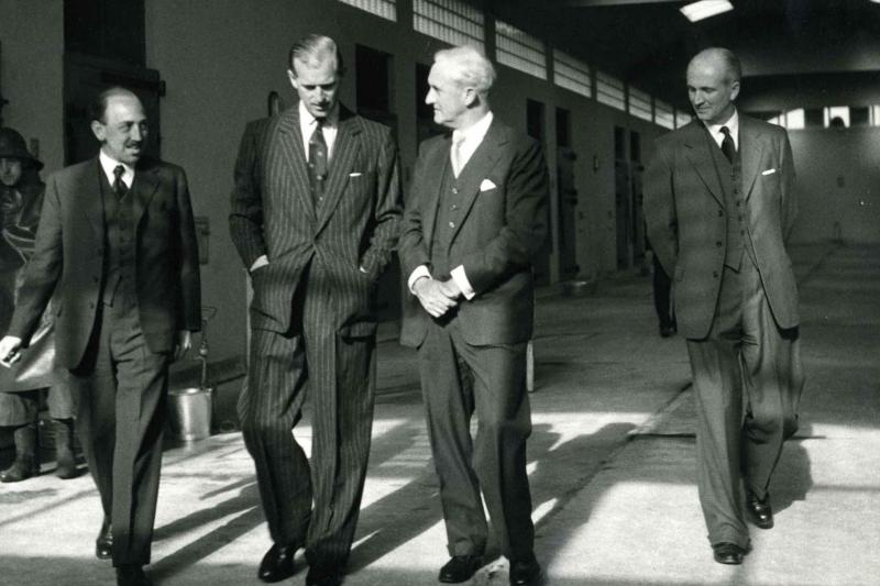 HRH Prince Philip, The Duke of Edinburgh, walks with 3 Pirbright staff on a 1956 visit