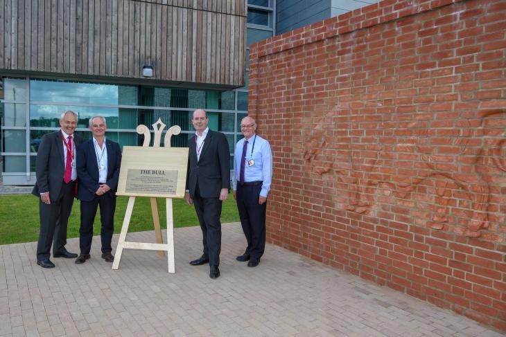 Sir John Kingman unveilling the brick bull in celebration of WLRFMD 60 years
