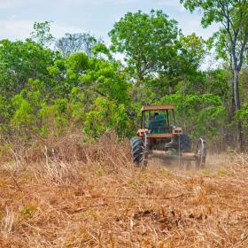 Agricultural tractor setting up pasture land stock photo